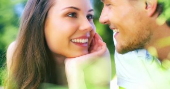 Attractive young couple gazing into each others eyes