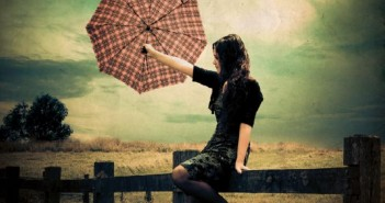 girl_in_rain_by_tatteredme-d4m9ees