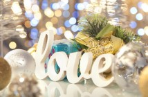 Love word with Christmas decorations and glowing background