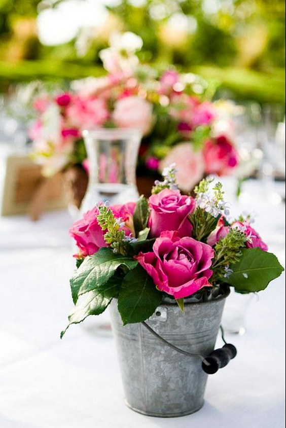 rustic-flowers-on-old-bucket-wedding-centerpiece