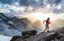 Trail running at sunset, with dramatic clouds and light, high in the Swiss Alps near the Glacier de Moiry, Switzerland