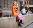 OSLO, NORWAY - AUGUST 14: Stephanie Broek wearing orange vinyl coat seen outside Epilogue during Oslo Runway SS19 on August 14, 2018 in Oslo, Norway. (Photo by Christian Vierig/Getty Images)